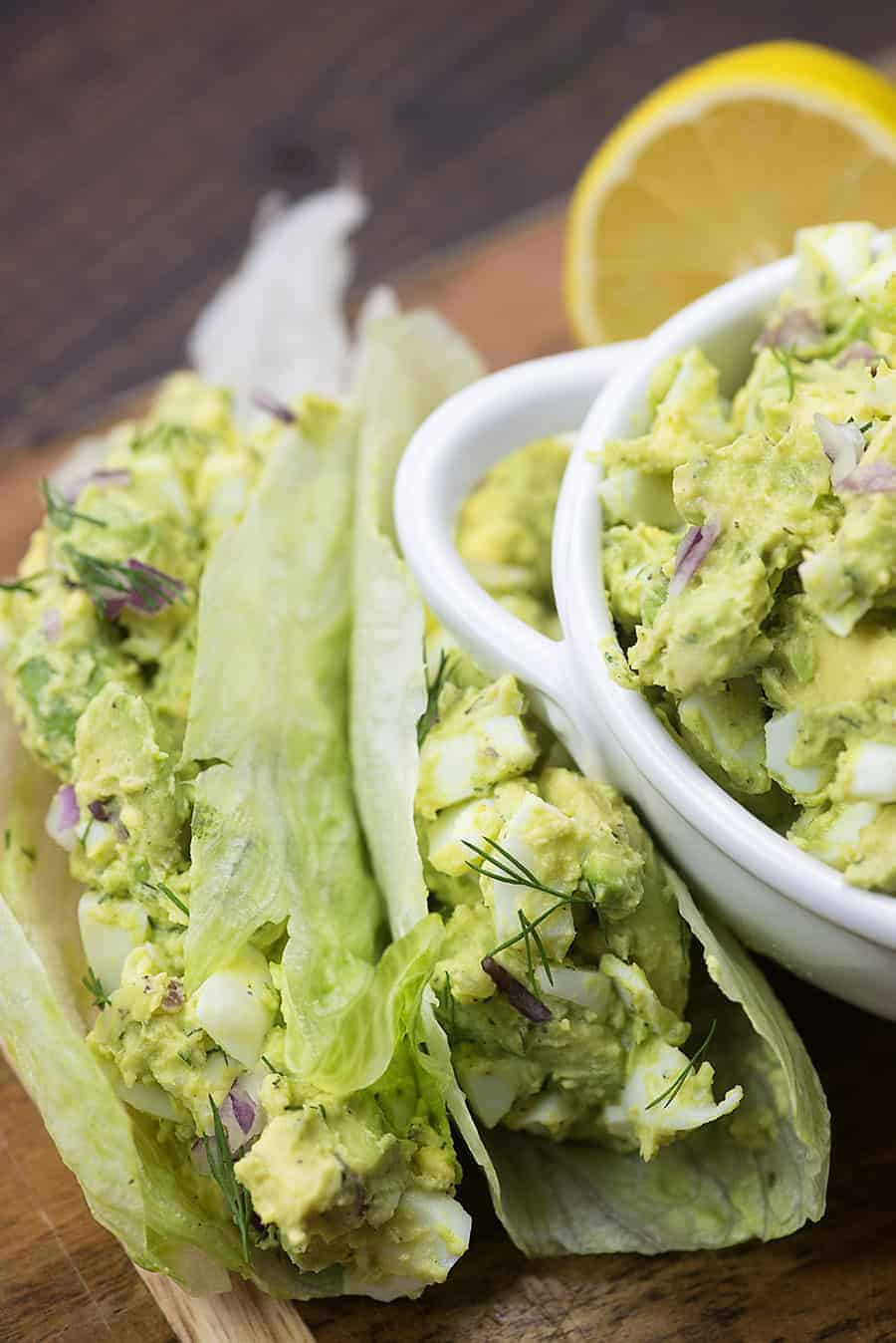 avocado egg salad in lettuce wrap on cutting board