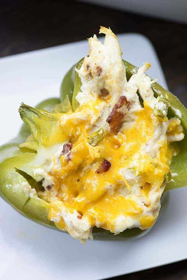 Bacon, chicken, and jalapeno popper dip fill these easy stuffed peppers!
