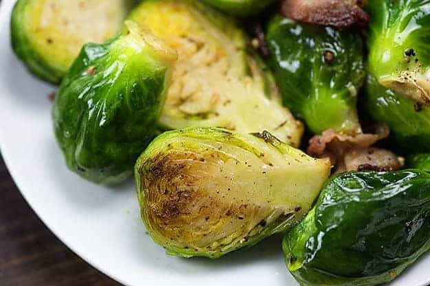 brussel sprouts and bacon on white plate