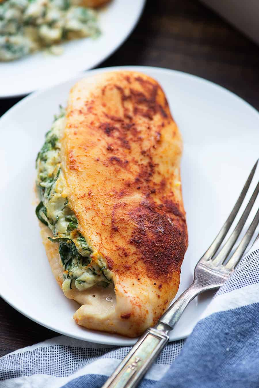 cheese stuffed chicken on white plate