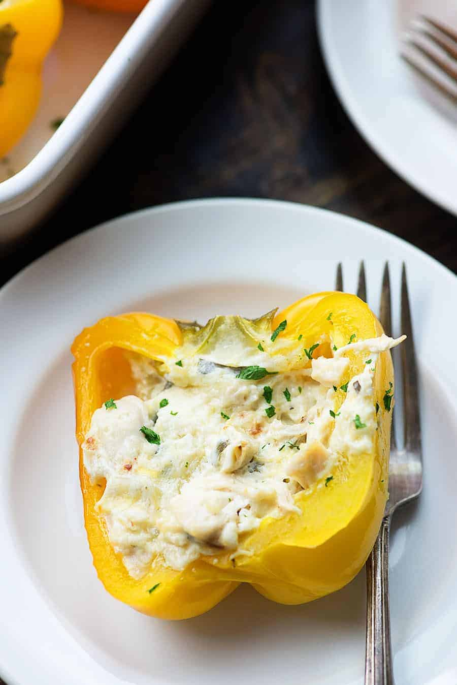 chicken stuffed peppers on white plate