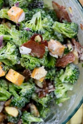 A close up of a salad and broccoli