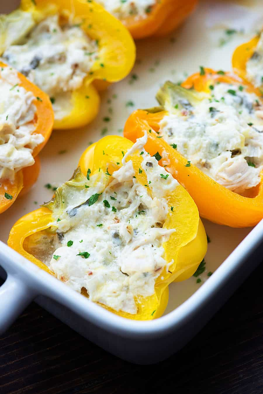 low carb stuffed peppers in white baking dish