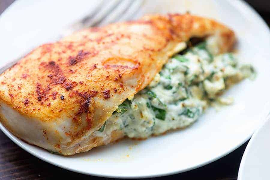 spinach stuffed chicken on plate