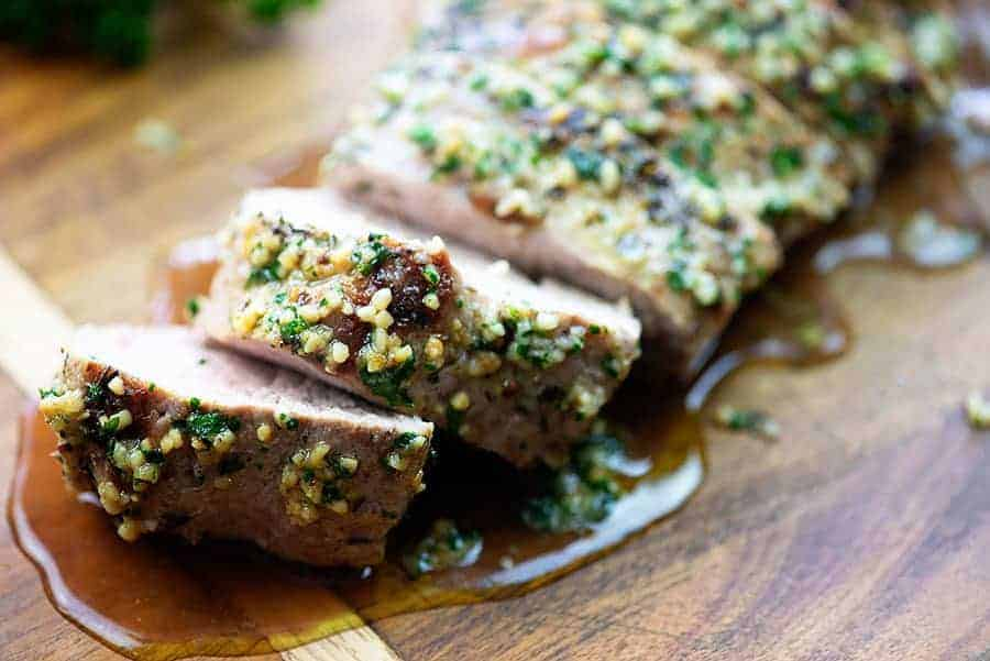 garlic pork tenderloin on cutting board