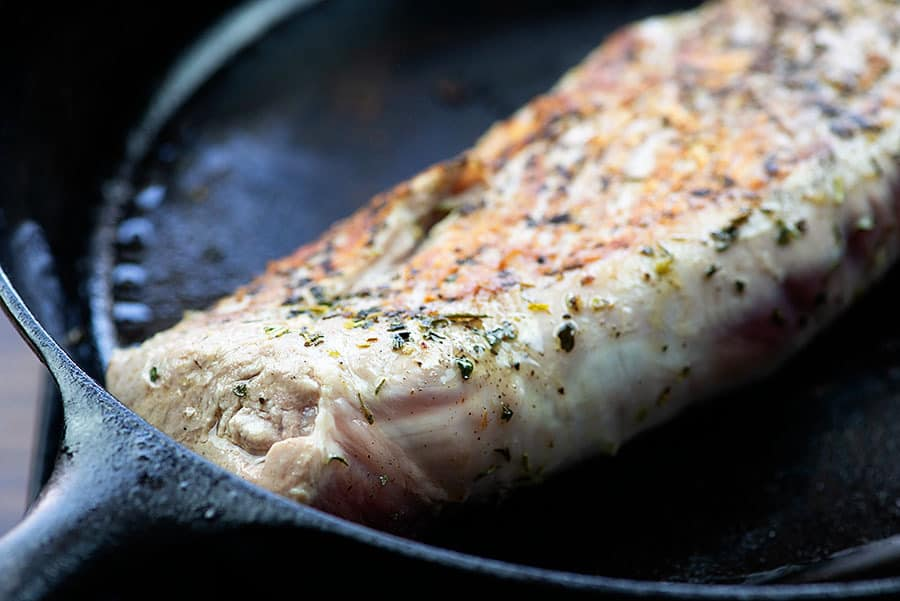 seared pork tenderloin in skillet