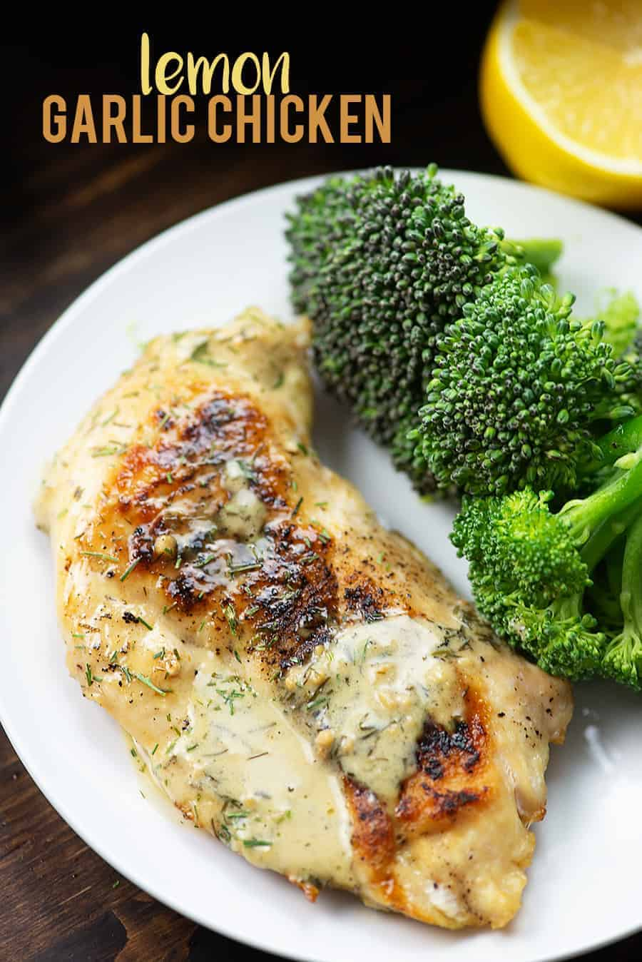 A plate of lemon chicken next to large broccoli pieces