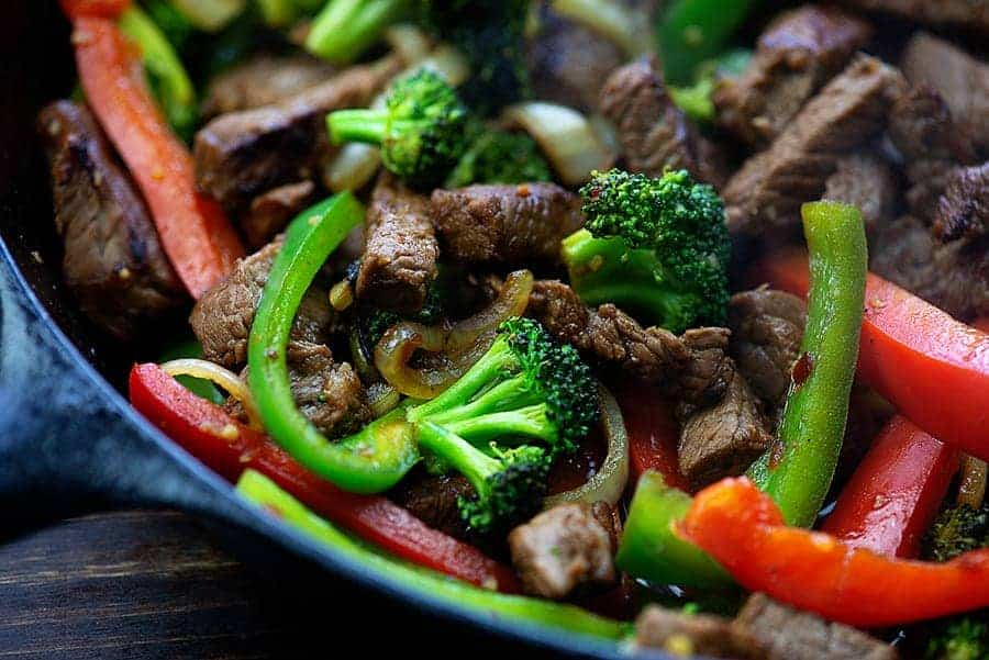 Close up of stir fry in cast iron skillet.