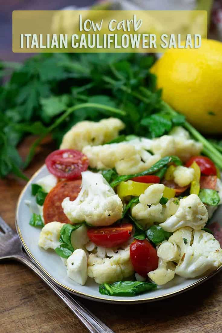 Italian Cauliflower Salad - this low carb alternative to pasta salad is loaded with pepperoni, tomatoes, spinach, fresh mozzarella, and more! #lowcarb #keto #cauliflower