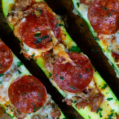 Three pieces of zucchini topped with cheese and pepperoni