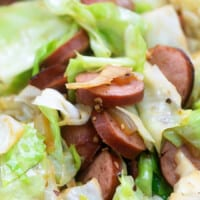A close up of Cabbage and Sausage mixed together