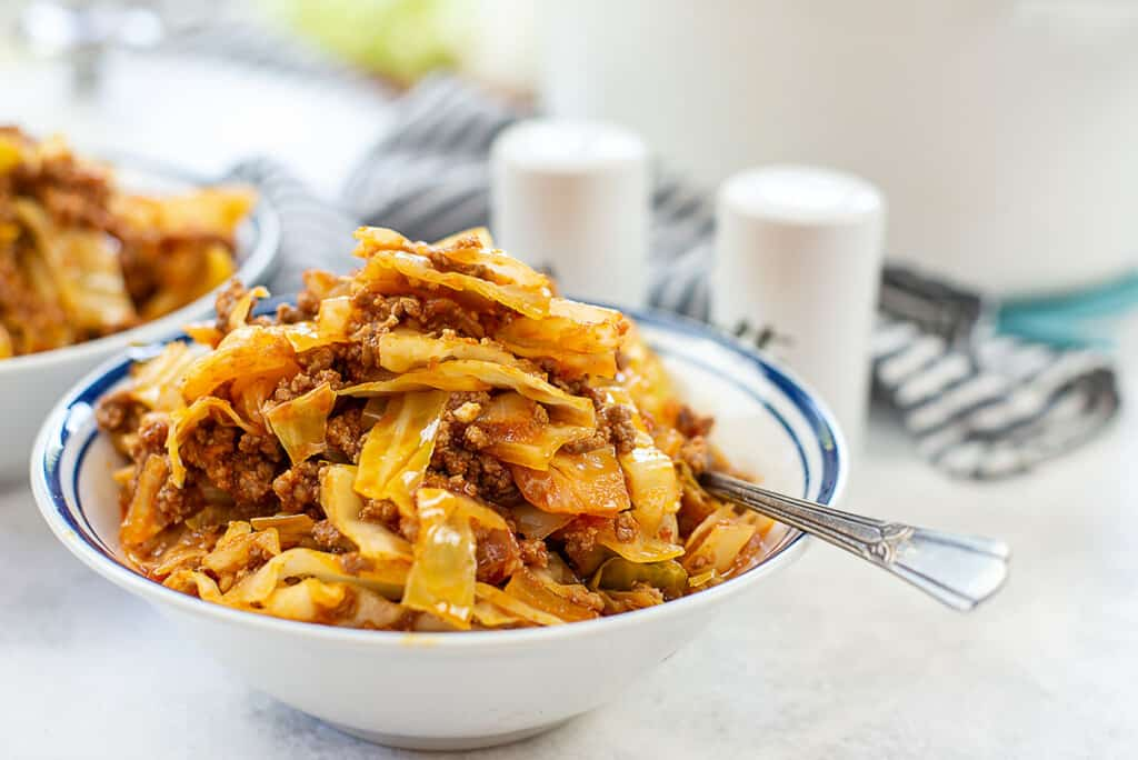 unstuffed cabbage rolls in white bowl.