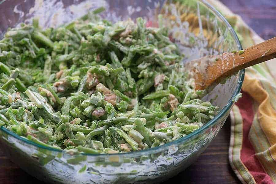 green bean casserole in glass mixing bowl