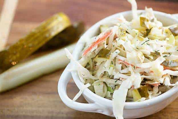 A white bowl of pickle slaw on a table