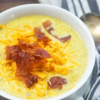 A bowl of soup, with Broccoli and Cheese soup