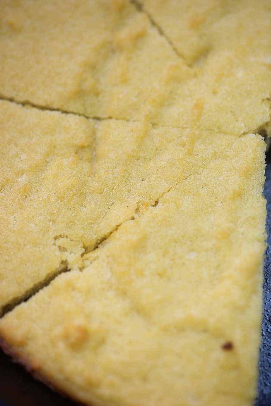 Low carb cornbread recipe! This low carb bread is beyond simple and the taste and texture are spot on! If you love cornbread, you have to try this with just 1 net carb per slice! #cornbread #keto #lowcarbbread