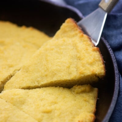 A bowl of food, with Cornbread
