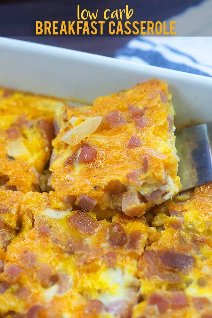 spatula scooping breakfast casserole out of a pan