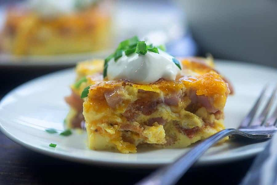 side view of a couple plates of breakfast casserole