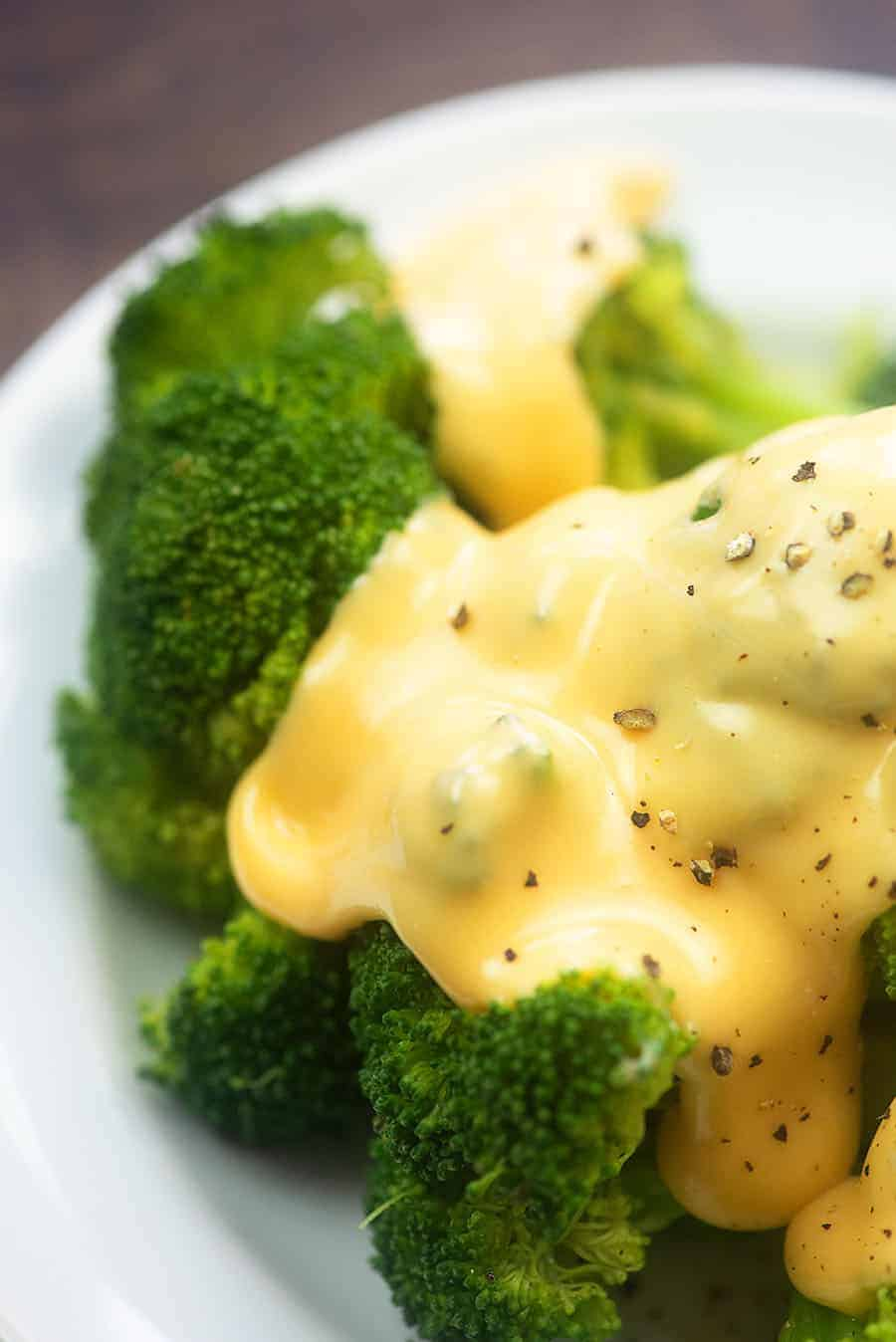 Low Carb Cheese Sauce! It's so smooth and creamy and is so perfect for pouring over broccoli! #cheese #lowcarb #keto