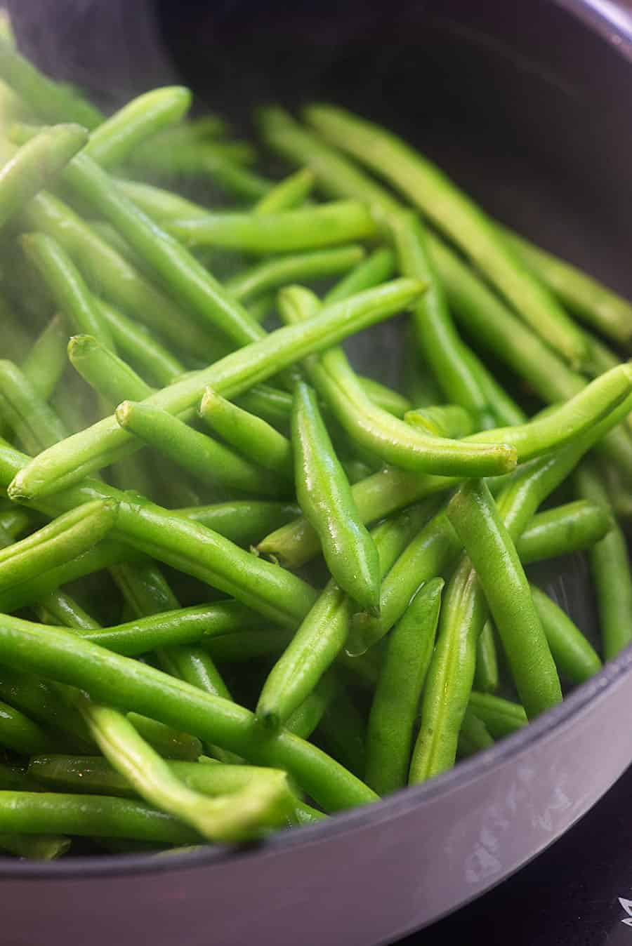 green beans in a pan cooking