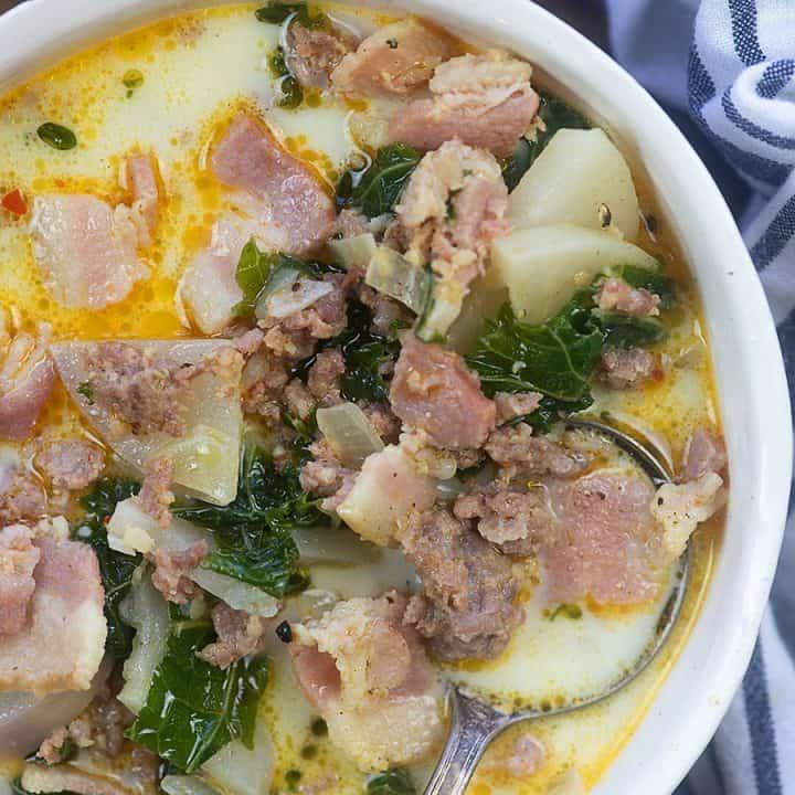 bowl of zuppa toscana with a soup spoon