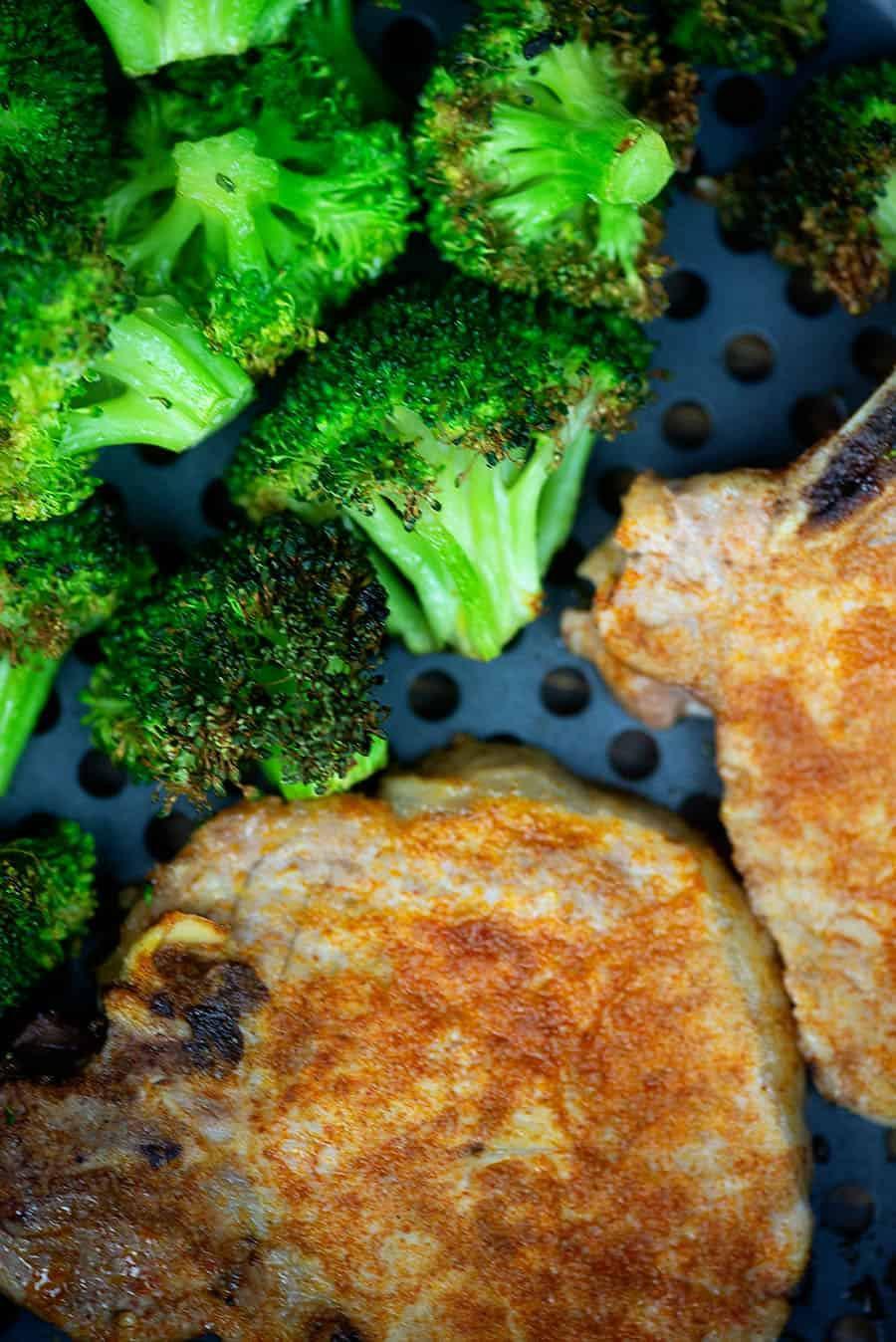 Air Fryer Pork Chops and Broccoli! Perfectly juicy pork chops and roasted broccoli all at once! #airfryer #porkchops #broccoli #easy