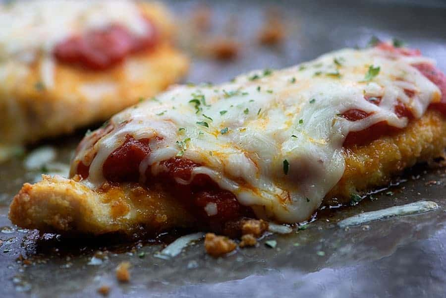 Low carb chicken parmesan doesn't get any easier than this! Crunchy chicken, delicious tomato sauce, and plenty of melty cheese!