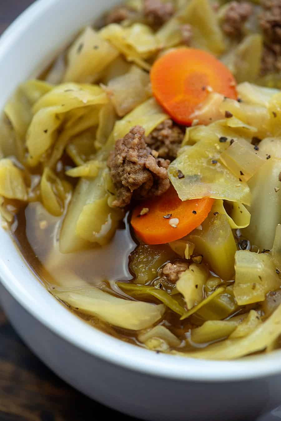 white bowl of beef and cabbage soup