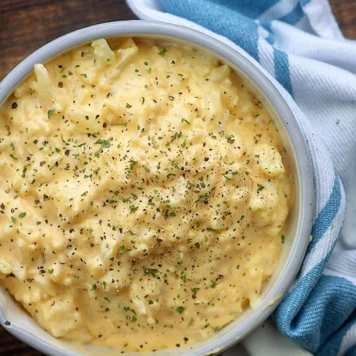 A bowl of food, with Cauliflower and Cheese
