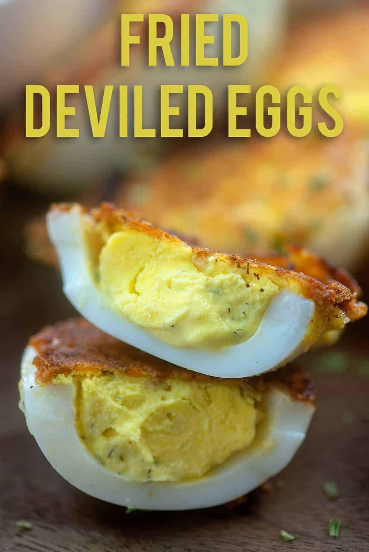 fried deviled eggs on cutting board