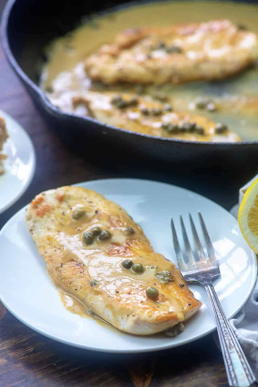 lemon caper chicken on white plate
