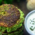 A close up of food, with Broccoli and Fritter