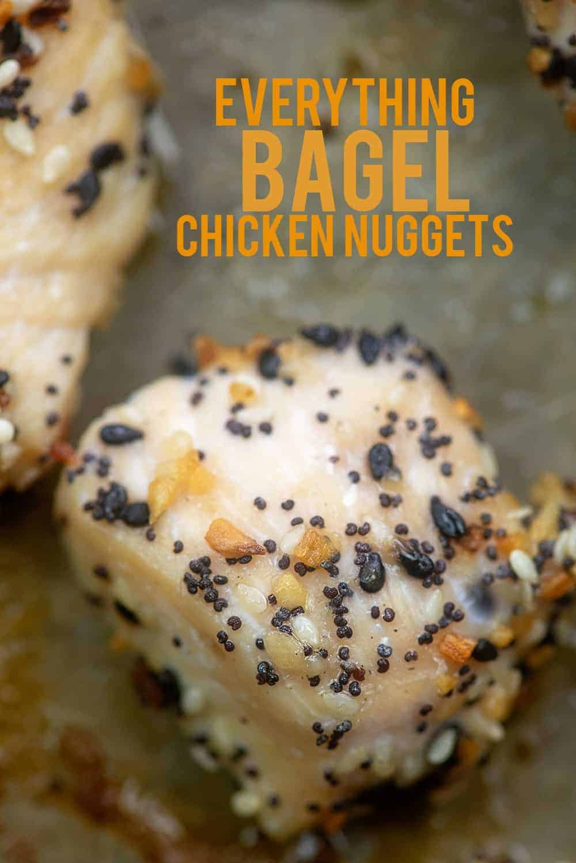 chicken nuggets coated in everything bagel seasoning on baking sheet.