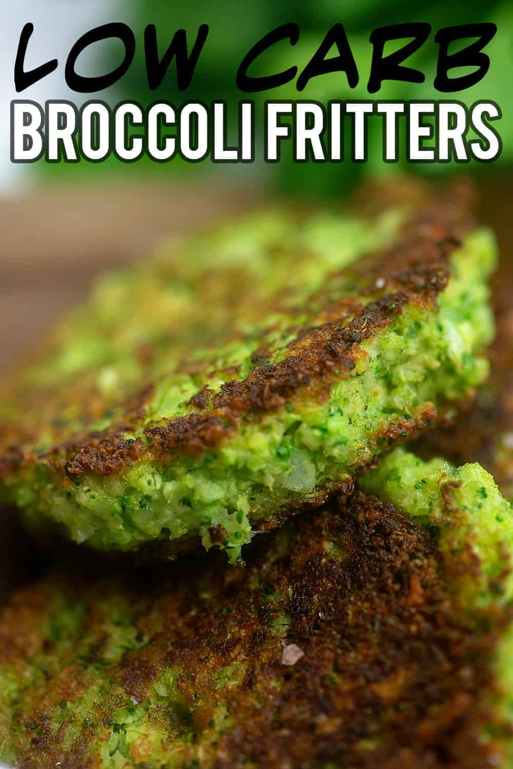 A close up of a broccoli fritter leaning against another fritter.