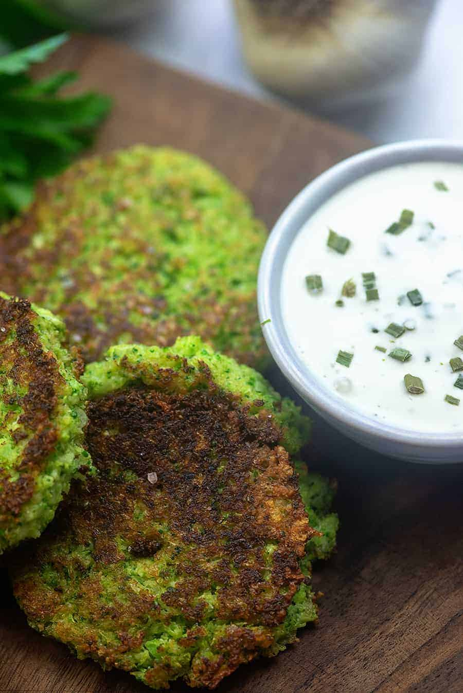 broccoli fritters on wooden cutting board.