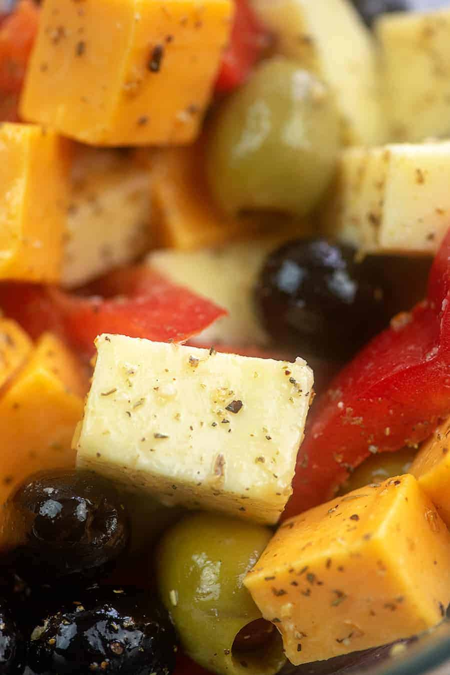 A close up of seasoned cheese and olives