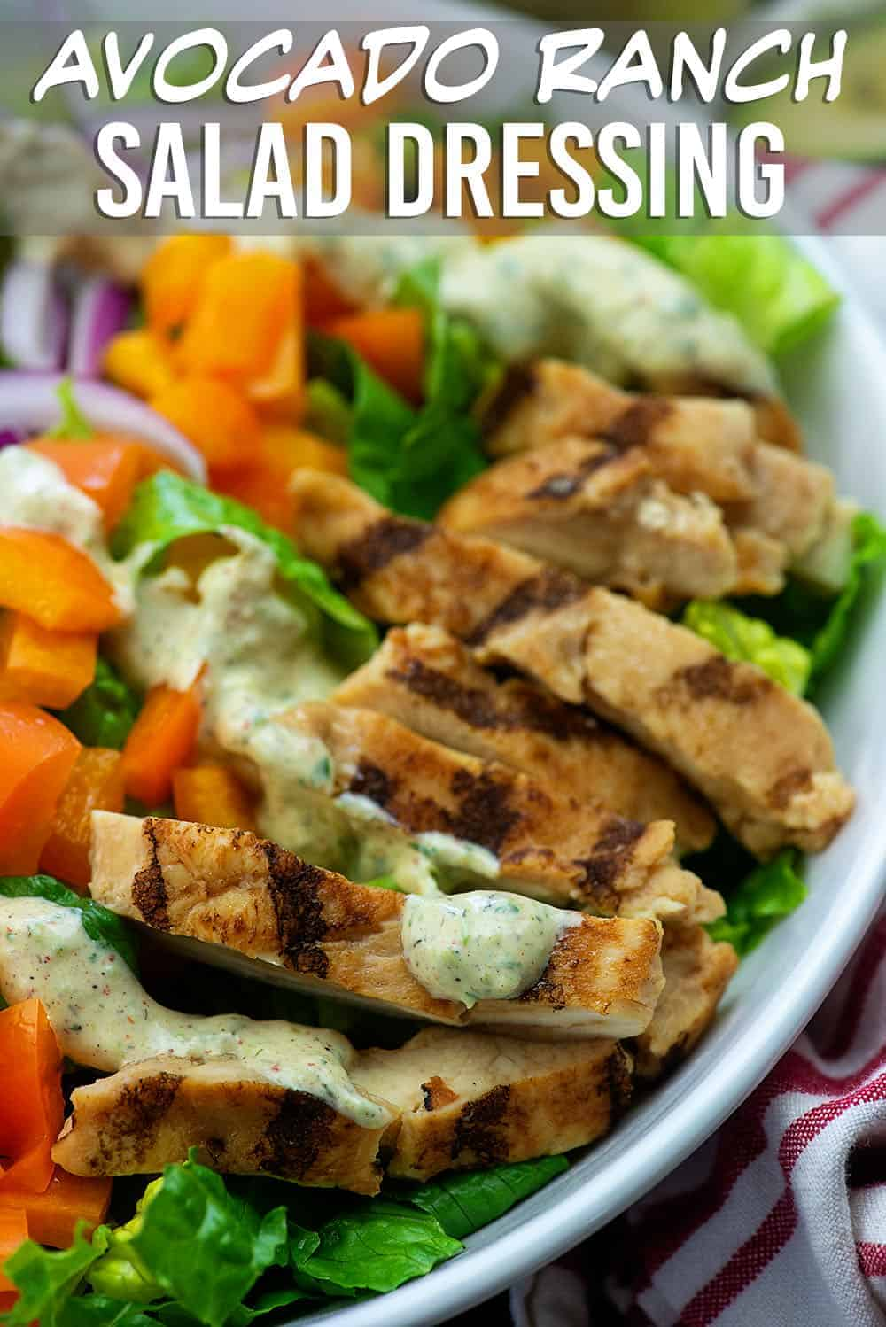 salad topped with chicken and dressing