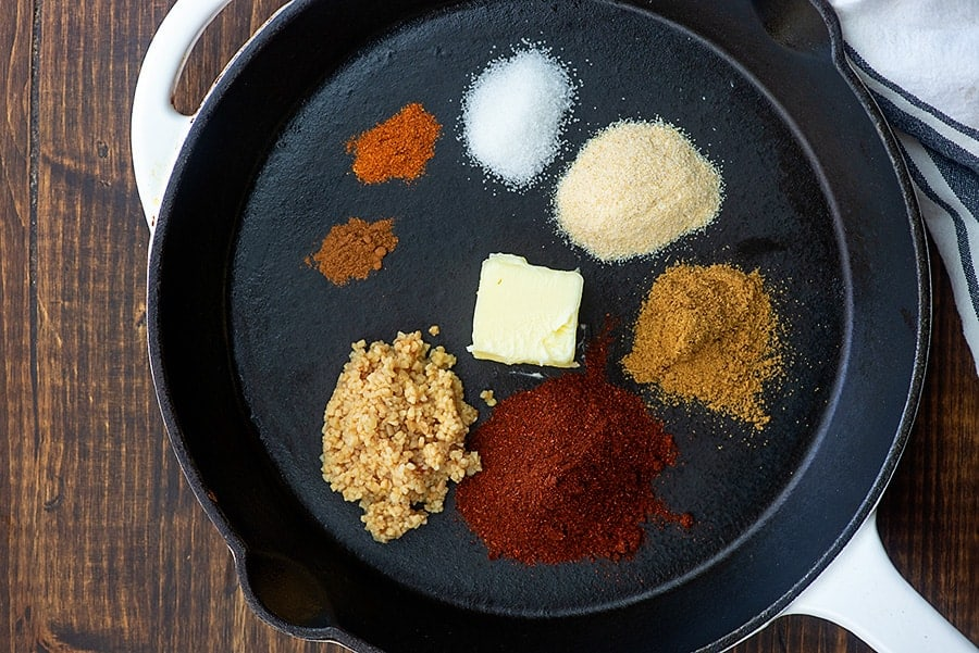 ingredients for gluten free enchilada sauce in skillet
