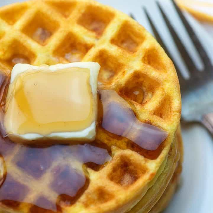 A plate of food with a fork, with Waffle