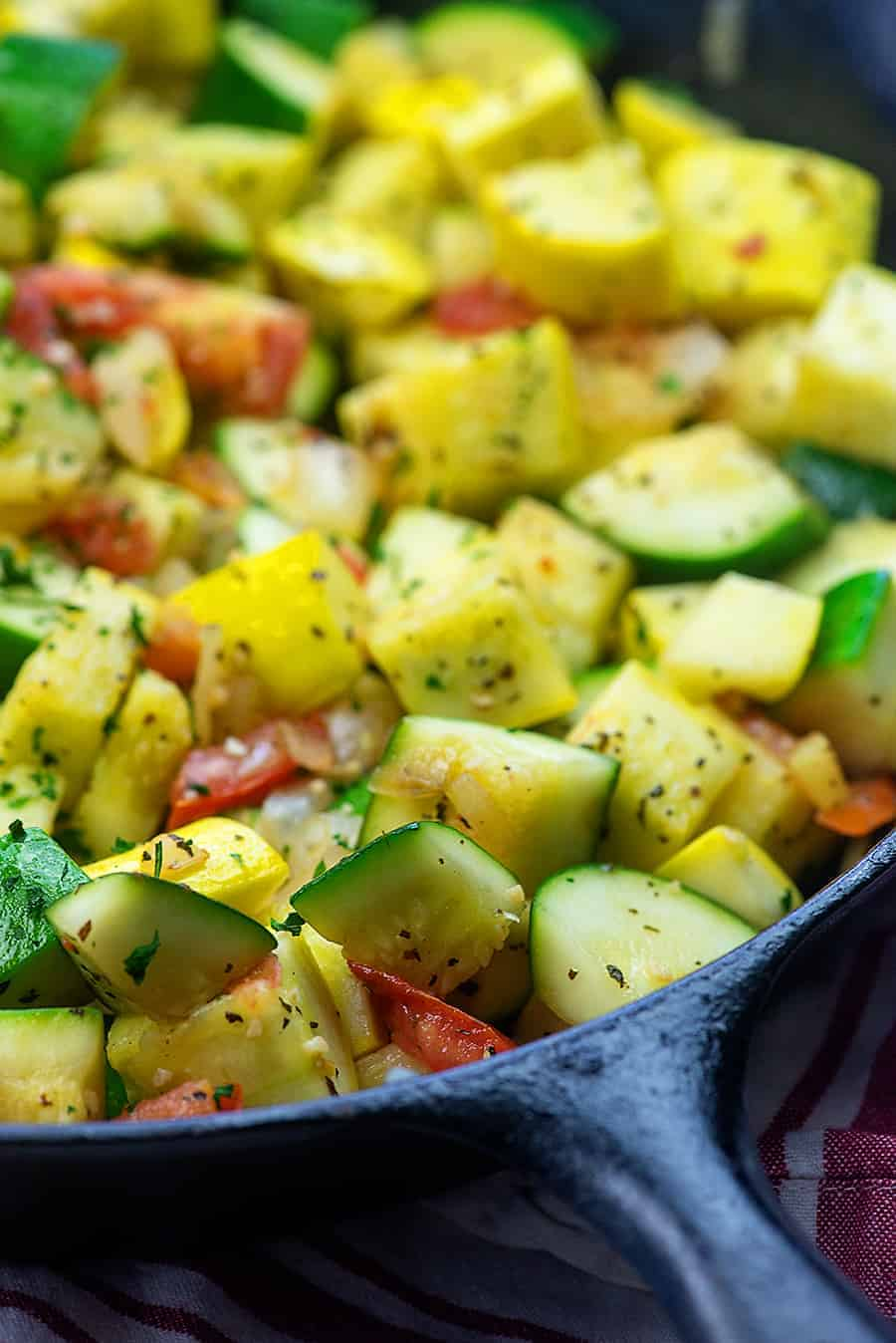 sauteed zucchini and squash in a cast iron skillet
