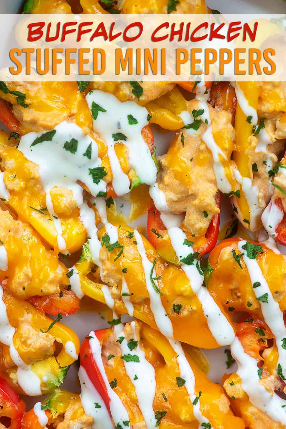 mini peppers stuffed with cheese and chicken and topped with ranch dressing