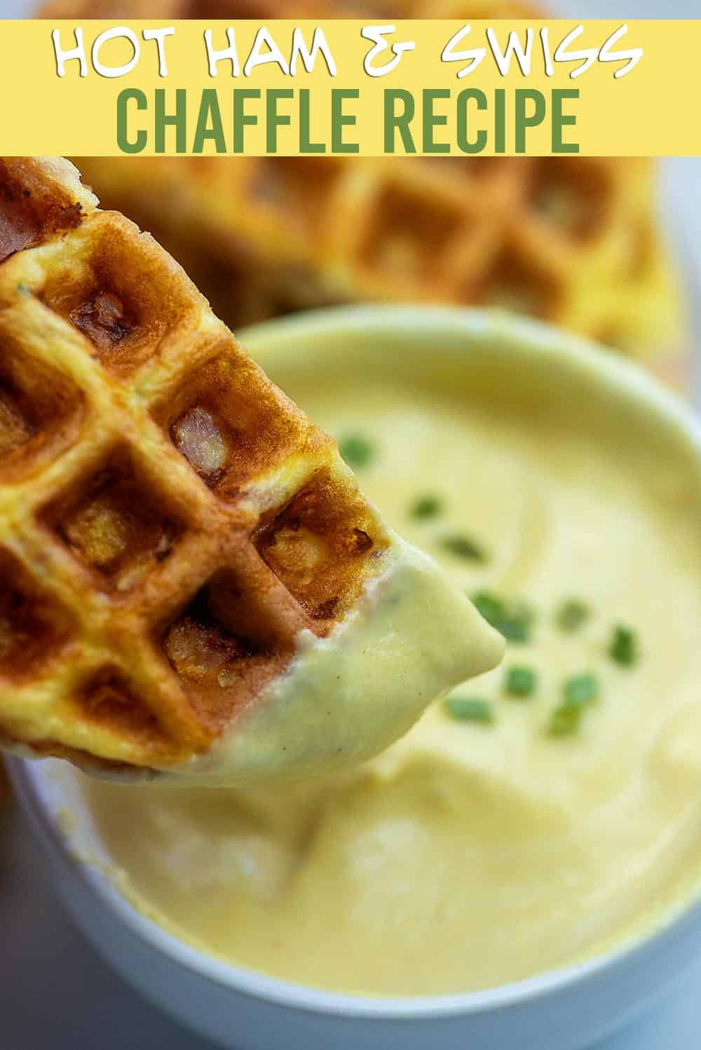 A close up of a chaffle being dipped into a cheese sauce