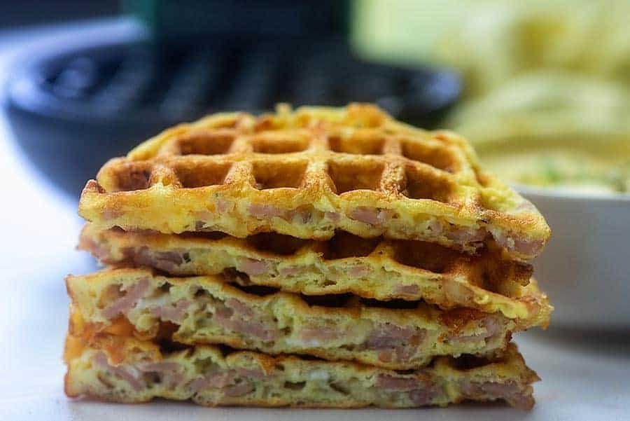 A close up of four stacked ham and cheese chaffles