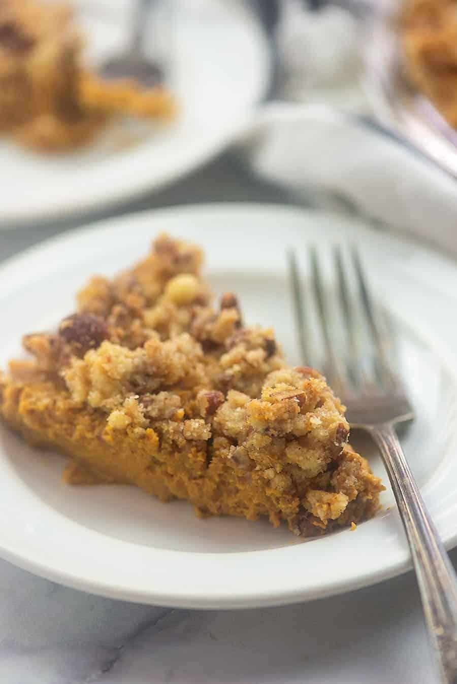A close up of a plate of pumpkin pie
