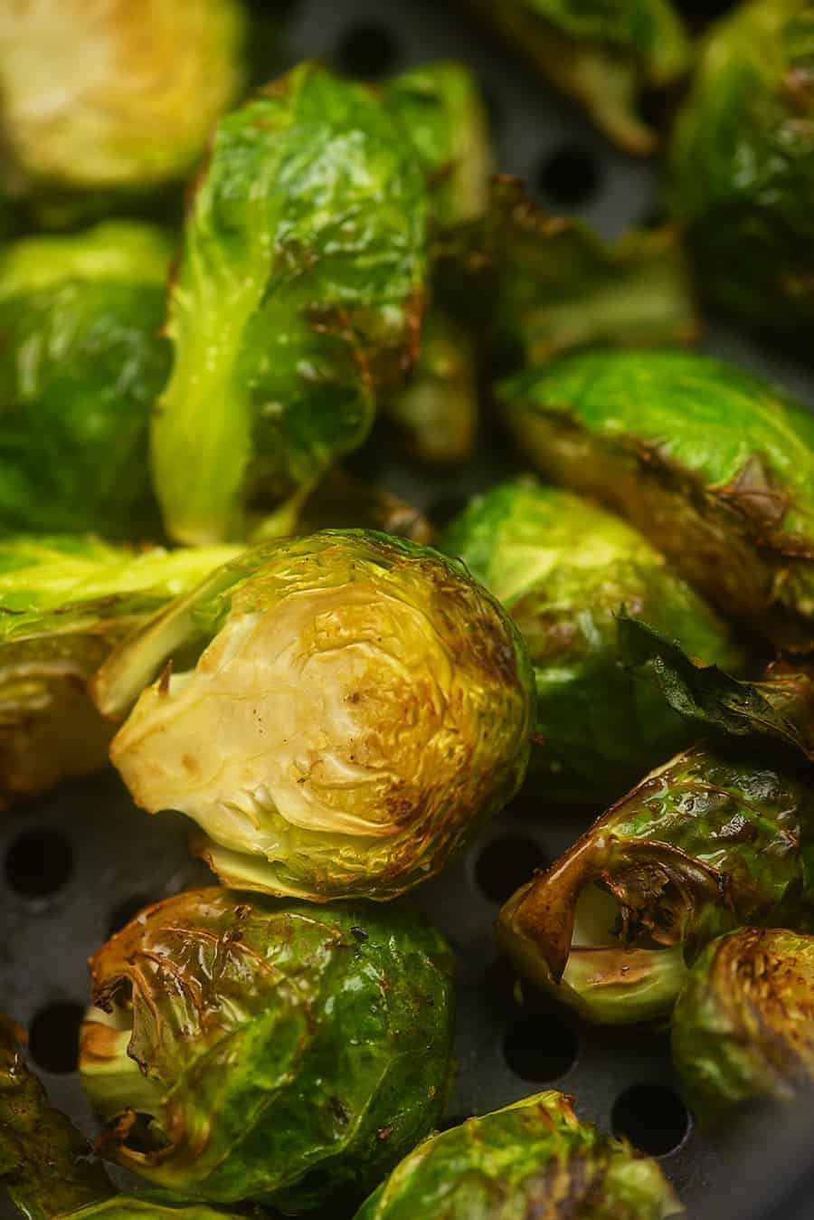 cooked brussel sprouts on an air fryer pan