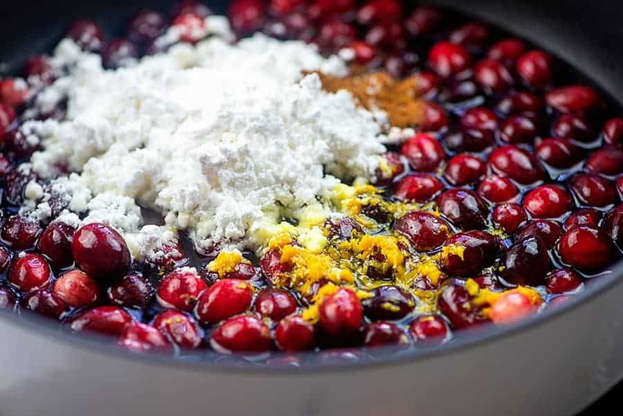ingredients for keto cranberry sauce in saucepan