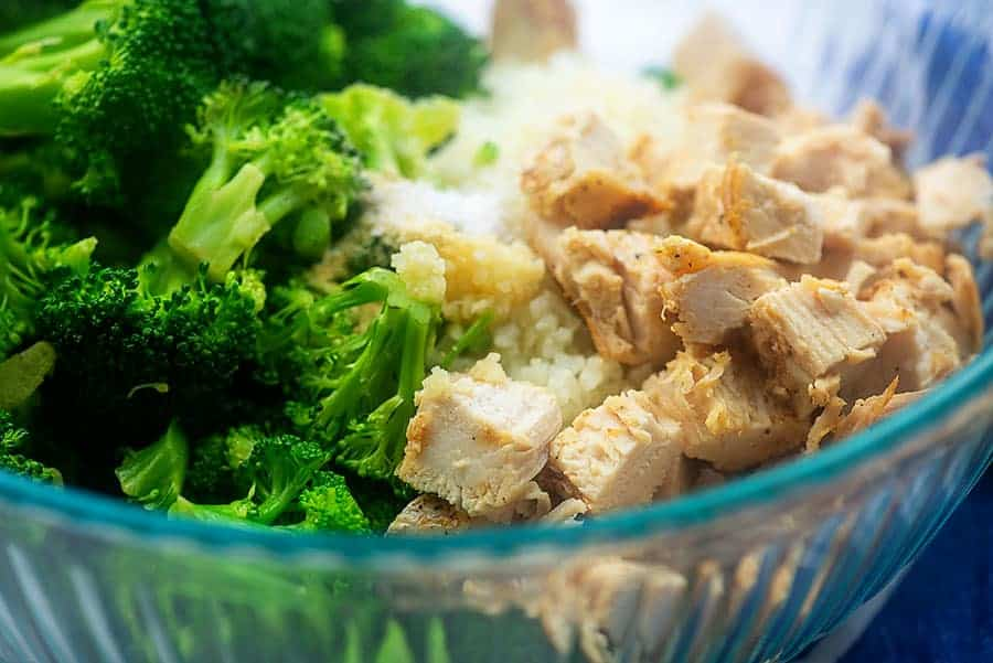 ingredients for chicken broccoli alfredo bake in a glass bowl