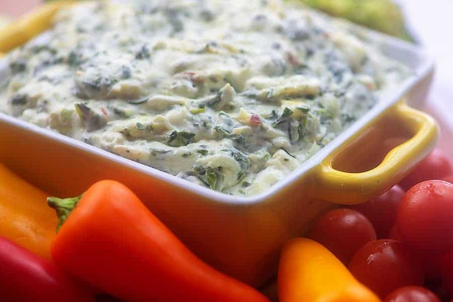 keto spinach dip in yellow bowl with vegetables