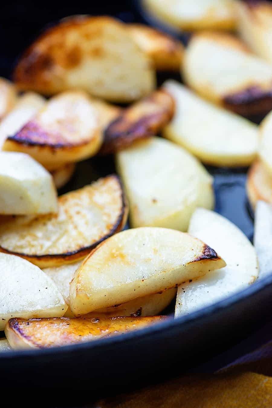 cooked turnips in a black cast iron skillet